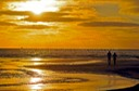 BROAD HAVEN BEACH ( north ) people in sunset on beach