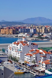 MARINA AND BOATS IN GIBRALTAR AND THE TOWN OF LA LINEA